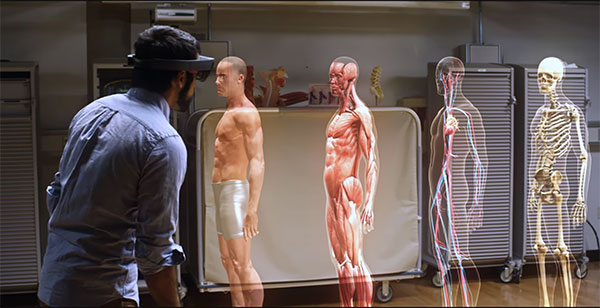 CWRU meducail student using Microsoft HoloLens looking at the human body